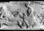Roman relief carving of a midwife attending a woman giving birth.